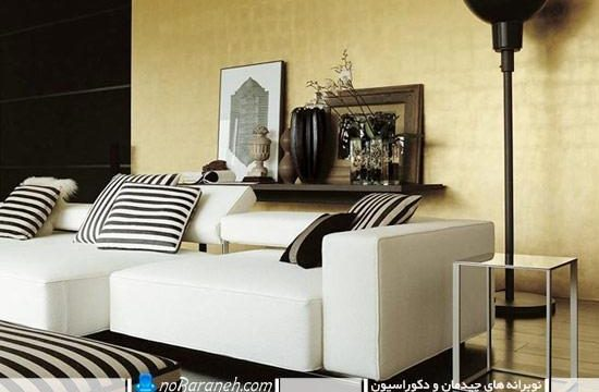 مدل مبلمان راحتی سفید رنگ با کوسن سیاه و سفید