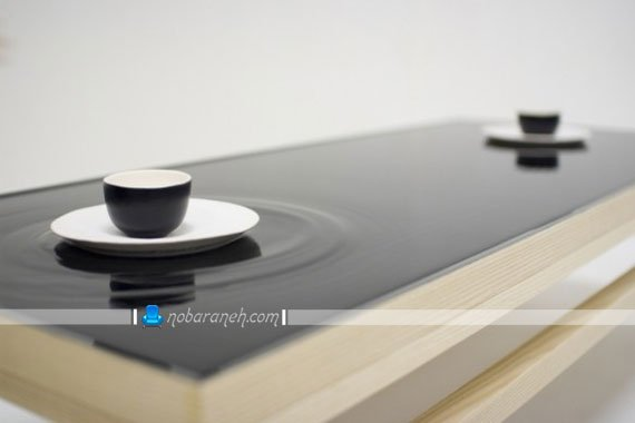 میز جلو مبلی با رویه موج دار و سیاه رنگ / عکس