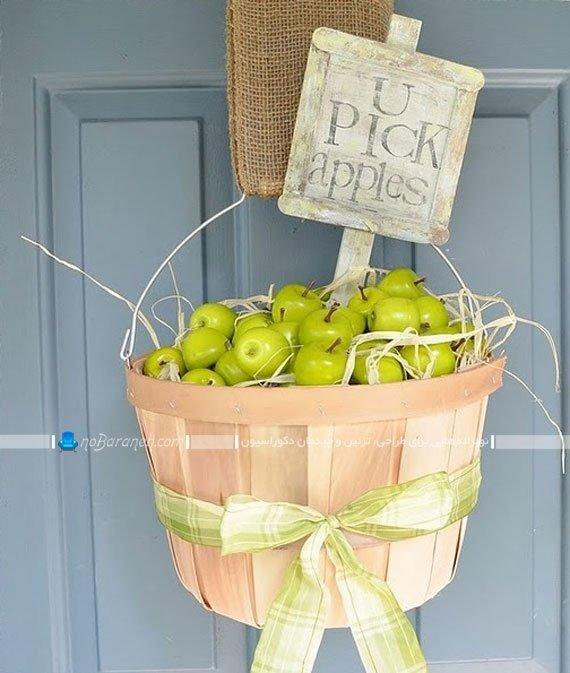 تزیین و دیزاین در ورودی با سبد سیب های مصنوعی / عکس
