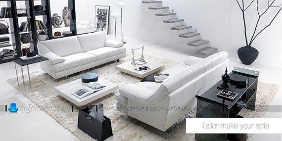 چیدمان شیک مبلمان راحتی سفید به شکل دو کاناپه روبرو