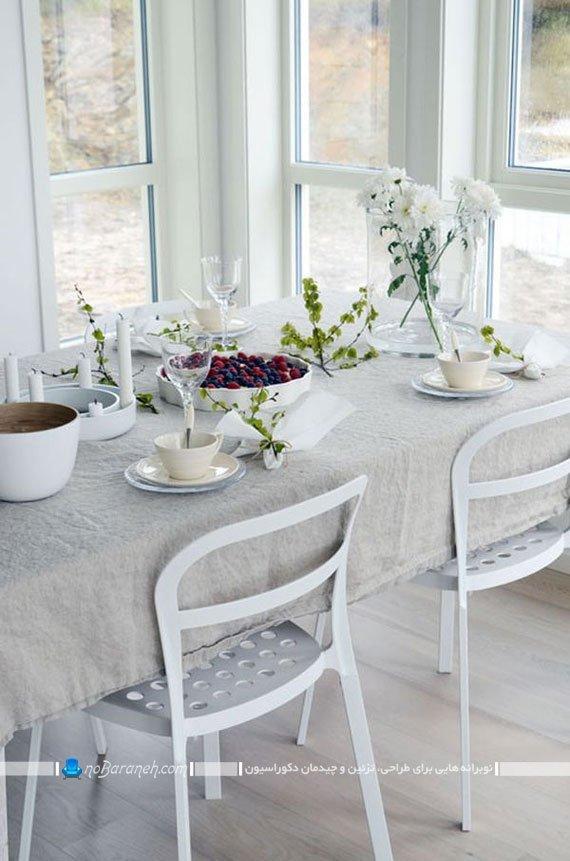 چیدمان میز ناهارخوری با صندلی پلاستیکی سفید