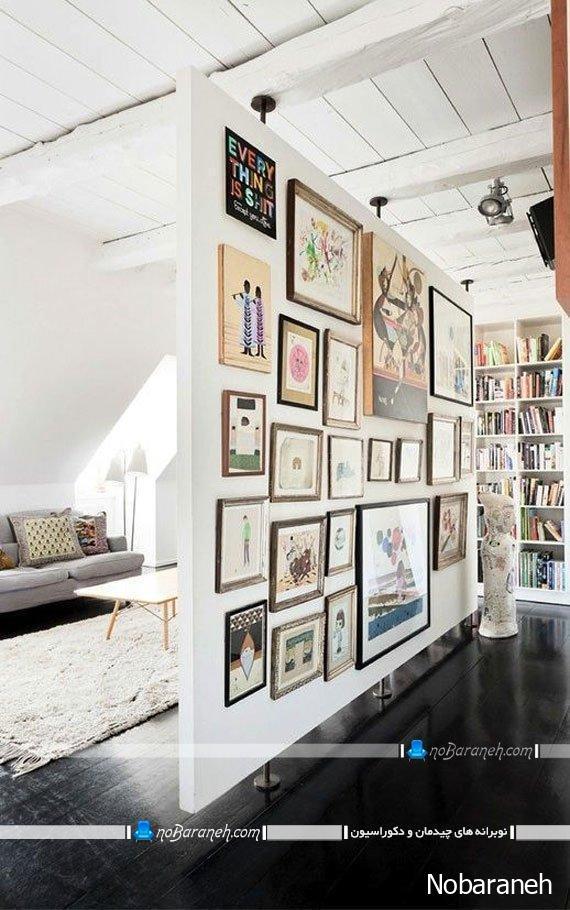 عکس پارتیشن چوبی ساده سفید رنگ که با تابلو تزیین شده است