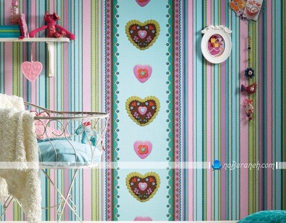 کاغذ دیواری اتاق نوزاد دختر با طرح قلب و رنگ بندی شاد