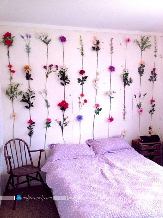 تزیین دیوار اتاق خواب با شاخه های گل و رنگ صورتی / عکس