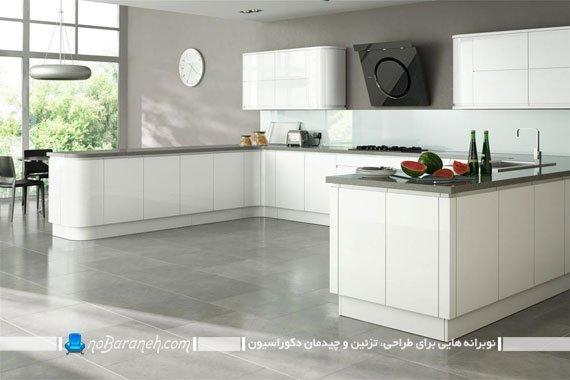 آشپزخانه بزرگ و مدرن با کابینت های سفید رنگ