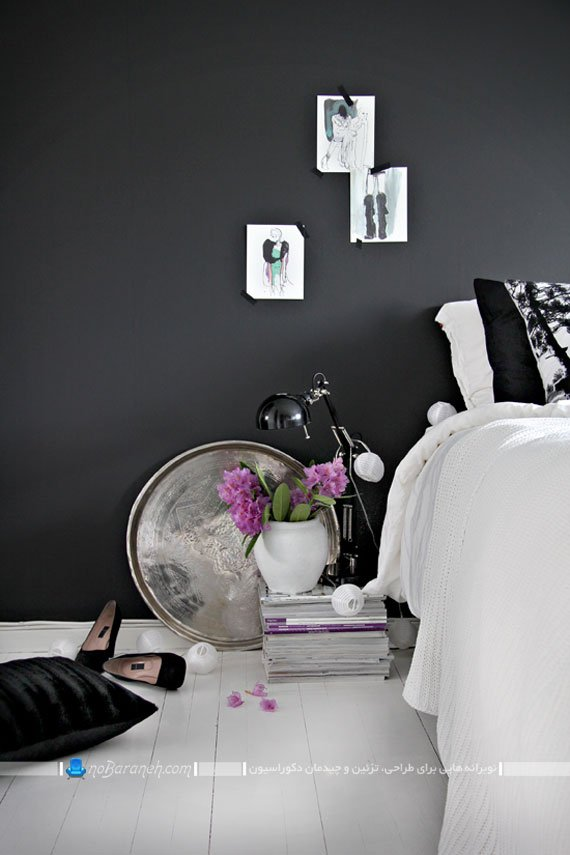 کفپوش سفید چوبی در کنار دیوار سیاه رنگ / عکس