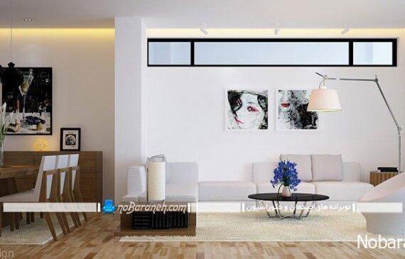 طراحی دکوراسیون داخلی شیک و مدرن با رنگهای خنثی مثل سفید و کرم، مدل کفپوش چوبی مدرن، چیدمان کنار هم مبلمان راحتی و میز ناهارخوری در اتاق پذیرایی