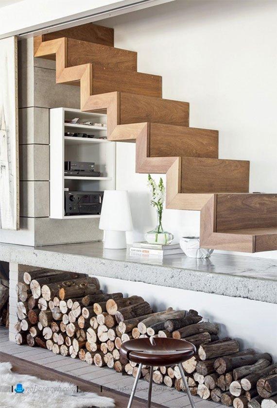 استفاده بهینه و تزئینی از فضاهای خالی زیر پله دوبلکس برای قرار دادن وسایل