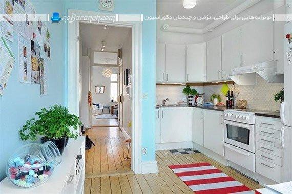 آشپزخانه کوچک دیزاین شده و پوشش داده شده با رنگ سفید
