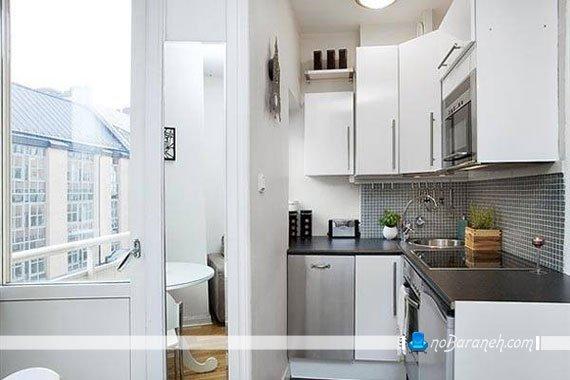 طراحی دکوراسیون آشپزخانه کوچک با کابینت های سفید و مشکی