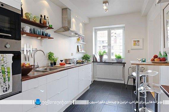 ایجاد تضاد در آشپزخانه با کابینت های سفید و کفپوش های سنگی مشکی