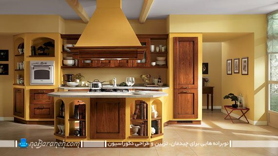 آشپزخانه جزیره ای با طراحی دکوراسیون کلاسیک. آشپزخانه کلاسیک با رنگ آمیزی زیبا شیک جذاب. دکوراسیون کلاسیک و سنتی آشپزخانه