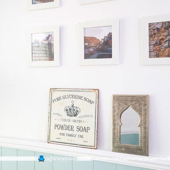 تزیین دیوارهای حمام با آینه و تابلو