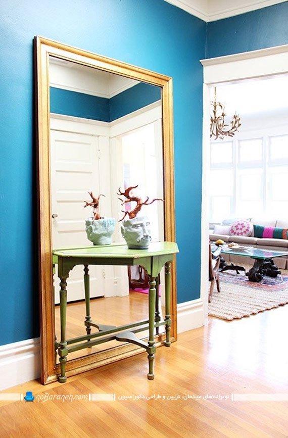آینه بزرگ تزیینی با فریم طلایی برای راهرو خانه