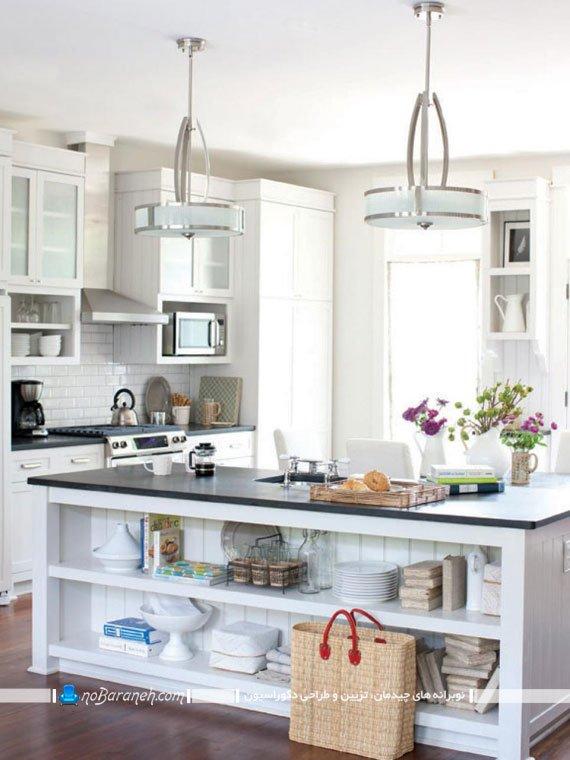 مدل آشپزخانه جزیره با میز سیاه و سفید