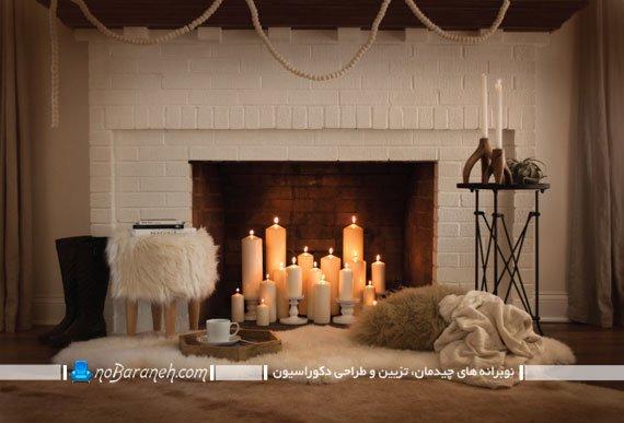 تزیین شومینه خاموش با شمع های استوانه ای