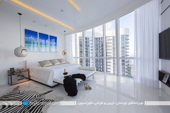 ایجاد نقطه کانونی در اتاق خواب با تابلو دکوراتیو، طراحی دکوراسیون اتاق خواب با رنگ سفید