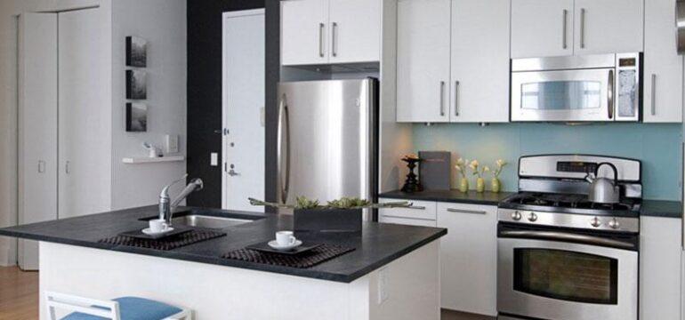 مدل کابینت مدرن هایگلاس با رنگ سفید و صفحه سیاه