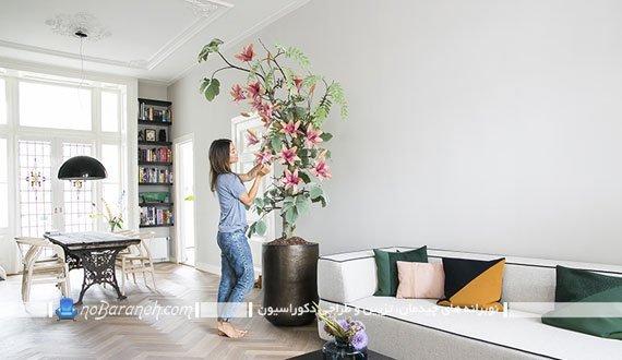 تزیین اتاق پذیرایی با گلدان گل مصنوعی