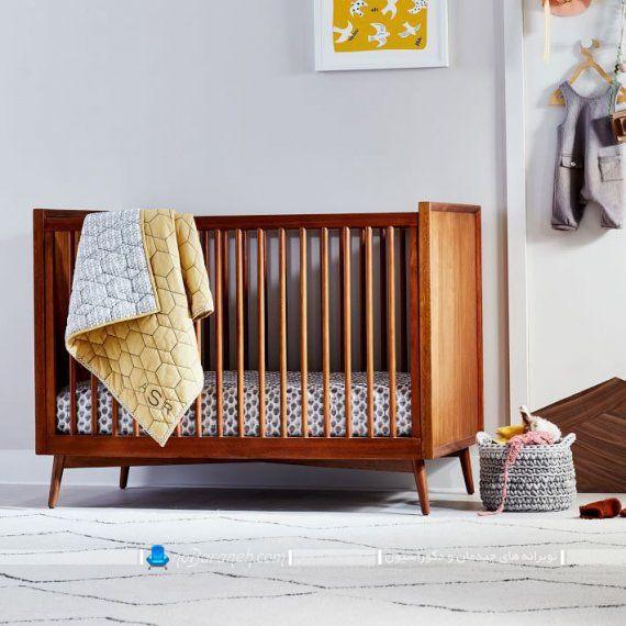 تخت خواب نوزاد با طراحی ساده و مدرن
