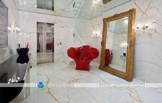 آینه تزئینی و کلاسیک سلطنتی برای لابی ساختمان. مدل های شیک آینه های بزرگ زمینی برای چیدمان در روی زمین با قاب طلایی رنگ طرح دار منبت کاری شده. آینه قدی بزرگ و سلطنتی کلاسیک مجلل شیک فانتزی
