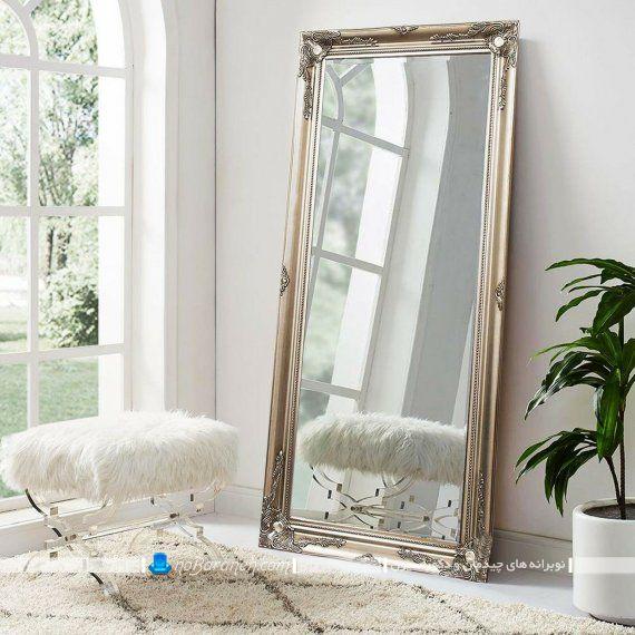 آینه دکوراتیو کلاسیک و سلطنتی قاب دار برنزی برای دکوراسیون اتاق پذیرایی و اتاق خواب. مدل جدید آیینه کلاسیک قاب دار شیک در مدل قدی طرح سنتی. آینه قدی کلاسیک بلند و کشیده. مدل جدید آئینه قدی زیبا