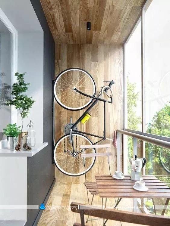 کفپوش و دیوارپوش چوبی تراس و بالکن ایوان در مدلهای جدید شیک مدرن. تزیینات جدید و فانتزی مثل دوچرخه برای دیزاین تراس و بالکن منزل.