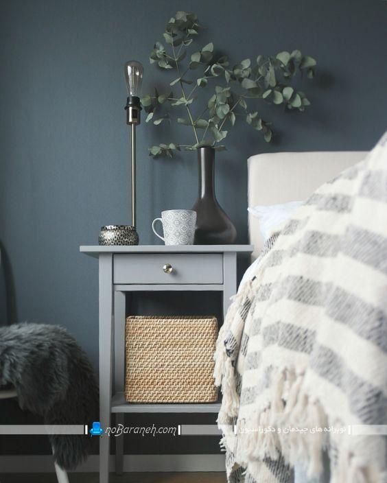 عکس مدل میز پاتختی کنار تخت چوبی در مدل کشو دار ساده شیک مدرن از برندهای معروف. تزیینات روی میز پاتختی و کنارتختی.