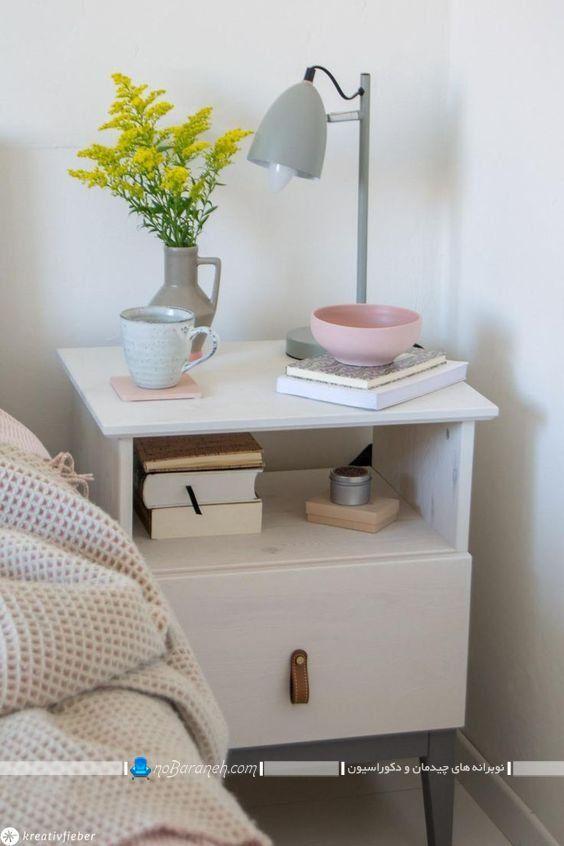 میز پاتختی کمد دار و قفسه دار سفید رنگ ساده شیک مدرن در طرح و مدل جدید. مدل های تزیین روی میز پاتختی و کنار تختی