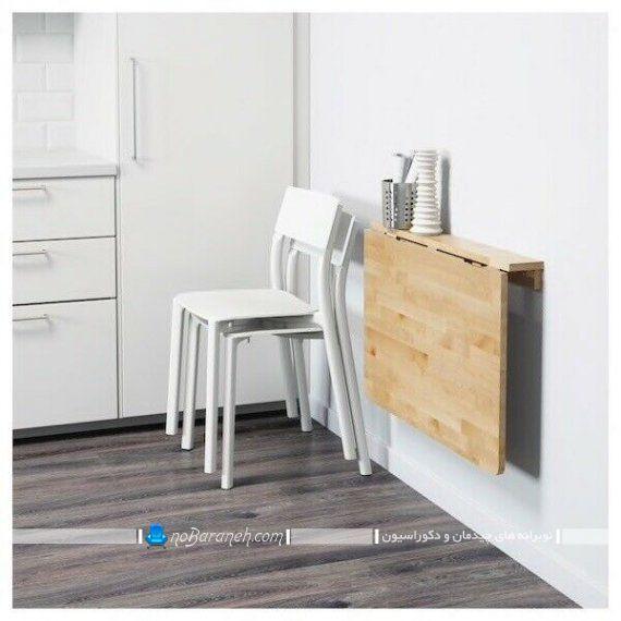 دکوراسیون آشپزخانه کوچک با میز اپن و میز ناهارخوری کوچک دیواری کم جا با طراحی جدید و شیک چوبی.