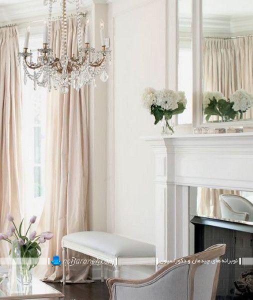 دکوراسیون شیک اتاق پذیرایی به سبک پاریسی کلاسیک و سنتی. مدل لوستر کریستال اتاق پذیرایی و آینه تزیینی برای دیزاین اتاق پذیرایی و نشیمن.