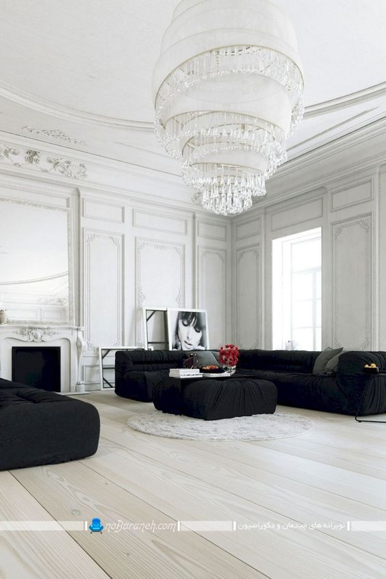 دکوراسیون شیک و مدرن پذیرایی به سبک پاریسی. مدل لوستر سلطنتی اتاق پذیرایی با ابعاد بزرگ و ست شده با گچبری سلطنتی اتاق پذیرایی.