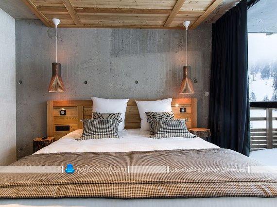 دکوراسیون چوبی در اتاق خواب روستیک. دکوراسیون شیک اتاق خواب با سقف و سرویس خواب چوبی.