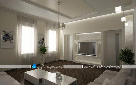 تزیین تلویزیون دیواری. دکوراسیون مدرن اتاق پذیرایی با رنگ سفید و کرم. مدل سه بعدی گرافیکی سالن پذیرایی